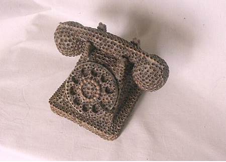 Missing Elements, Telephone, sculpture by Gina Telocci created from brown seed pods