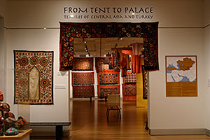 Gallery view of From Tent to Palace showing a display of rich colored textiles